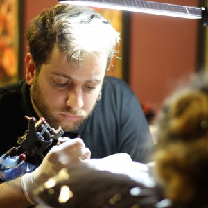 tattoo artist working