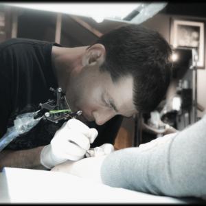 Liran raskin making a tattoo